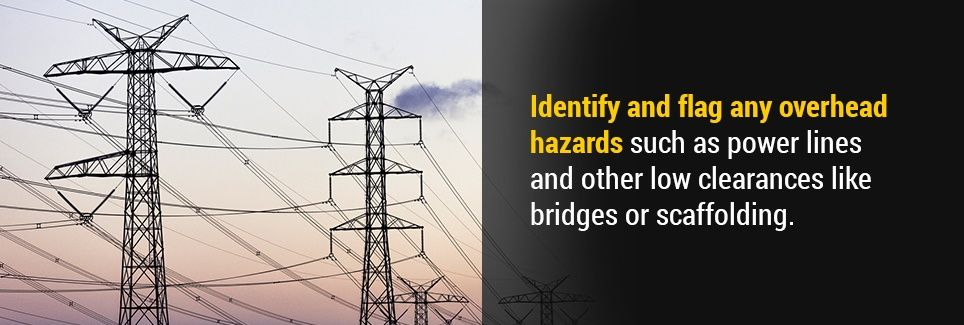 Identify and flag any overhead hazards such as power lines and other low clearances like bridges or scaffolding.