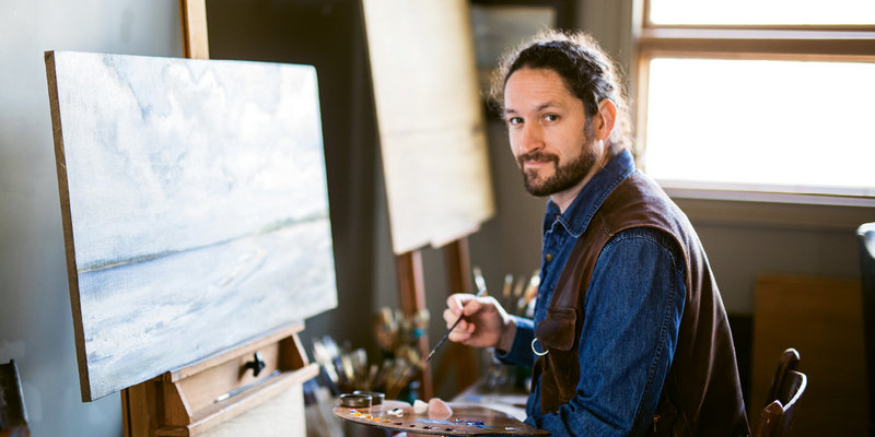 Artist Christopher Holt engaged in landscape painting