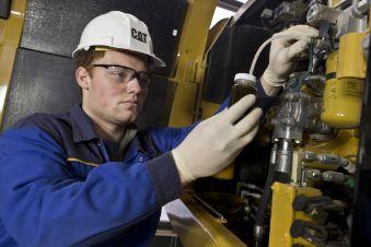 Cat technician taking an oil sample